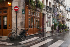 Paris cafe. Some windows of cafe and bicycle standing in the rain Stock Photo