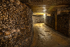 Paris-Catacombs-Dead-3. The Realm of the Dead, the Catacombs of Paris or Catacombes de Paris are underground ossuaries in Paris, France. Halls and caverns of Royalty Free Stock Images