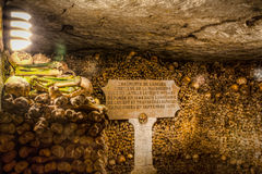 Paris-Catacombs-Dead-5. The Realm of the Dead, the Catacombs of Paris or Catacombes de Paris are underground ossuaries in Paris, France. Halls and caverns of Stock Photo