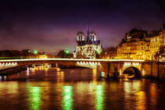 Paris cathedral at night Stock Photography