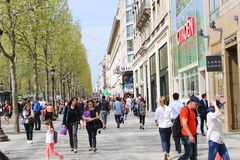 Paris, Champ Elysee street. Apr 16 2015,Shoppers and tourists in Paris on  enjoy the sights on the well known Champ Elysee. Champ Elysee is arguably the most Royalty Free Stock Photos