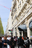 Paris, Champ Elysee street. Apr 16 2015,Shoppers and tourists in Paris on  enjoy the sights on the well known Champ Elysee. Champ Elysee is arguably the most Stock Photo