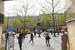 Paris, Champ Elysee street. Apr 16 2015,Shoppers and tourists in Paris on  enjoy the sights on the well known Champ Elysee. Champ Elysee is arguably the most Royalty Free Stock Images