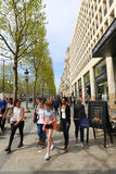 Paris, Champ Elysee street. Apr 16 2015,Shoppers and tourists in Paris on  enjoy the sights on the well known Champ Elysee. Champ Elysee is arguably the most Royalty Free Stock Photography