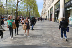 Paris, Champ Elysee street. Apr 16 2015,Shoppers and tourists in Paris on  enjoy the sights on the well known Champ Elysee. Champ Elysee is arguably the most Royalty Free Stock Photo