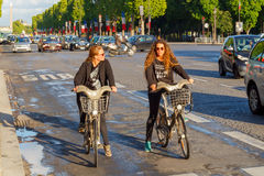Paris. Champs - Elysees. Paris, France - May 11, 2014: Cyclists on the Champs Elysees in Paris on a spring morning stock photos