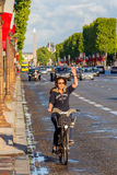 Paris. Champs - Elysees. Paris, France - May 11, 2014: Cyclists on the Champs Elysees in Paris on a spring morning stock image