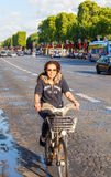 Paris. Champs - Elysees. Paris, France - May 11, 2014: Cyclists on the Champs Elysees in Paris on a spring morning royalty free stock images