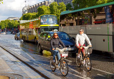 Paris. Champs - Elysees. Paris, France - May 11, 2014: Cyclists on the Champs Elysees in Paris on a spring morning royalty free stock photo