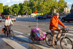 Paris. Champs - Elysees. Paris, France - May 11, 2014: Cyclists on the Champs Elysees in Paris on a spring morning. The focus in the background stock photography