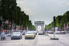 Paris. Champs Elysees. Very high resolution, 42.2 megapixels. Vehicles travel along avenue Champs Elysees - one of a famous touristic places in Paris, France stock photography