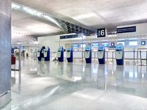 Paris-Charles de Gaulle at night. Paris-Charles de Gaulle with nobody, empty registration stands and check-in self-service terminals at night time Royalty Free Stock Images
