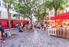 PARIS - CIRCA JUNE, 2014: Tourists in beautiful streets of Montmartre Stock Photo
