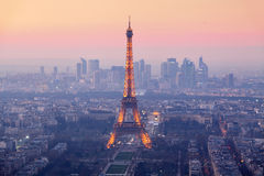 Paris city with Eiffel tower at dusk, cityspace. PARIS - FEBRUARY 7: Eiffel Tower brightly illuminated at dusk on FEBRUARY 7, 2015 in Paris. The Eiffel tower is Royalty Free Stock Photo