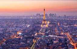 Paris city with Eiffel tower at dusk, cityspace. PARIS - FEBRUARY 7: Eiffel Tower brightly illuminated at dusk on FEBRUARY 7, 2015 in Paris. The Eiffel tower is Stock Image