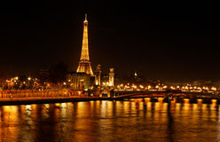 Paris - The City of Light. Paris,France-December 11, 2011: Night image of the Seine river and Eiffel Tower in Paris Royalty Free Stock Image