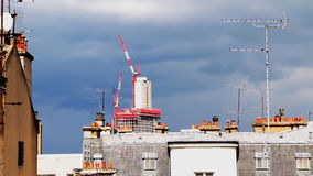 Paris city scape with roofs, cranes, dramatic skies, antennas, air vents. stock footage