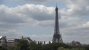 Paris City Time Lapse with Clouds Moving Fast Over Downtown and Eiffel Tower.  stock video footage