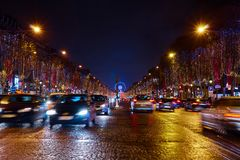 Christmas Illuminations of Champs Elysees. Traffic. Stock Image