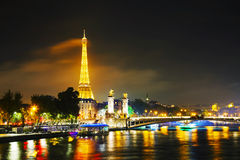 Paris cityscape with Eiffel tower at night. PARIS - OCTOBER 12: Paris cityscape with Eiffel tower on October 12, 2014 in Paris, France. It's an iron lattice Stock Photography