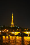 Paris cityscape with Eiffel tower at night. PARIS - OCTOBER 10: Paris cityscape with Eiffel tower on October 10, 2014 in Paris, France. It's an iron lattice Stock Images