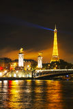 Paris cityscape with Eiffel tower at night. PARIS - OCTOBER 12: Paris cityscape with Eiffel tower on October 12, 2014 in Paris, France. It's an iron lattice Stock Images