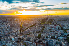 The Paris cityscape with Eiffel Tower at sunset Stock Images