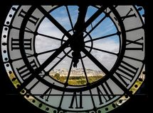 Paris cityscape through the giant clock at the Musee d'Orsay royalty free stock photography