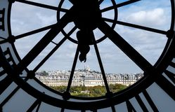 Paris cityscape through the giant glass clock at the Musee d`Orsay stock photos
