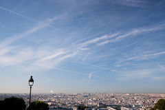 Paris cityscape with a lamp. Paris, France with a blue sky and a nearby lamp stock photo