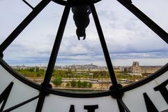 Paris cityscape, skyline view through the famous clock in the Orsay Museum. France. April 2019.  stock photography