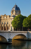 Paris Commercial Court monument and Pont au Change by the River Royalty Free Stock Image
