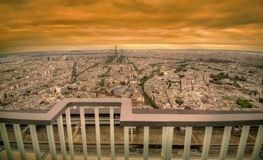 Paris dark sunset scene. Paris golden sunset panoramic cityscape with retro style vibrant colors Royalty Free Stock Photos