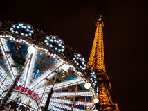 PARIS - DECEMBER 29: Eiffel Tower and antique carousel as seen at night on December 29, 2012 in Paris, France. The Eiffel tower is Stock Image