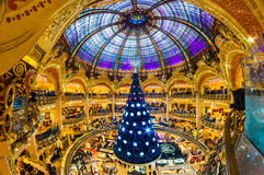 PARIS - DECEMBER 07: The Christmas tree at Galeries Lafayette on. December 07, 2012, Paris, France. The Galeries Lafayette has been selling luxury goods since stock image