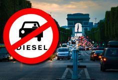 Paris Diesel driving ban - Diesel car Prohibition sign. Diesel car Prohibition signand Paris street with busy traffic blurred on the background. Symbolizing that royalty free stock image