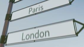 Paris direction sign on road signpost with European cities captions. 4K conceptual clip. Paris direction sign on road signpost with European cities captions. 4K stock footage
