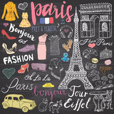 Paris doodles elements. Hand drawn set with eiffel tower bred cafe, taxi triumf arch, Notre Dame cathedral, fashion elements, cat Stock Images