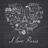 Paris doodles elements. Hand drawn set withefel tower bred cafe flowers and bicycle. Drawing doodle collection, in heart shape, on Stock Images