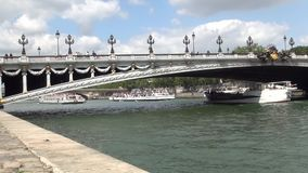Paris Downtown Image with Bridge Over Seine River and Tourists Boats Sailing.  stock video footage