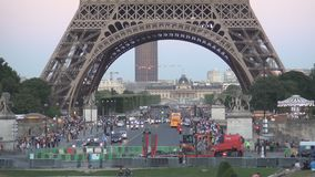 Paris downtown street image with tourists visiting Eiffel Tower.  stock video