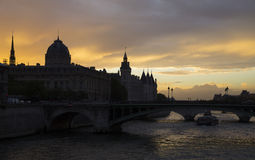 Paris at dusk time, Conciergerie and Pont au Change Royalty Free Stock Image