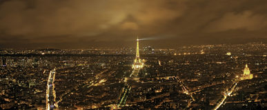 Paris, Eiffel and Illuminated streets on a cloudy night Royalty Free Stock Images