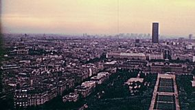 Champ de Mars 1970s panorama. Paris Eiffel Tower aerial view of Paris with Champ de Mars gardens panorama in the 70s. Historic archival footage from 1976 in stock footage