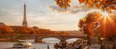 Paris with Eiffel Tower against autumn leaves in France royalty free stock photo