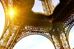 Paris, Eiffel Tower with Bright Sun. Wide Angle View from Below Stock Photo