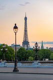 Paris Eiffel tower and lamppost with orange sky Stock Images