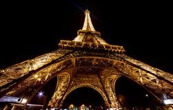 Paris Eiffel Tower by night. Purple light royalty free stock photos