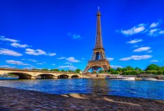 Paris Eiffel Tower and river Seine in Paris, France. Eiffel Tower is one of the most iconic landmarks of Paris royalty free stock photography