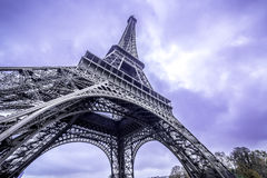 Paris. Eiffel Tower scenic bottom view. Purple sky Stock Photos